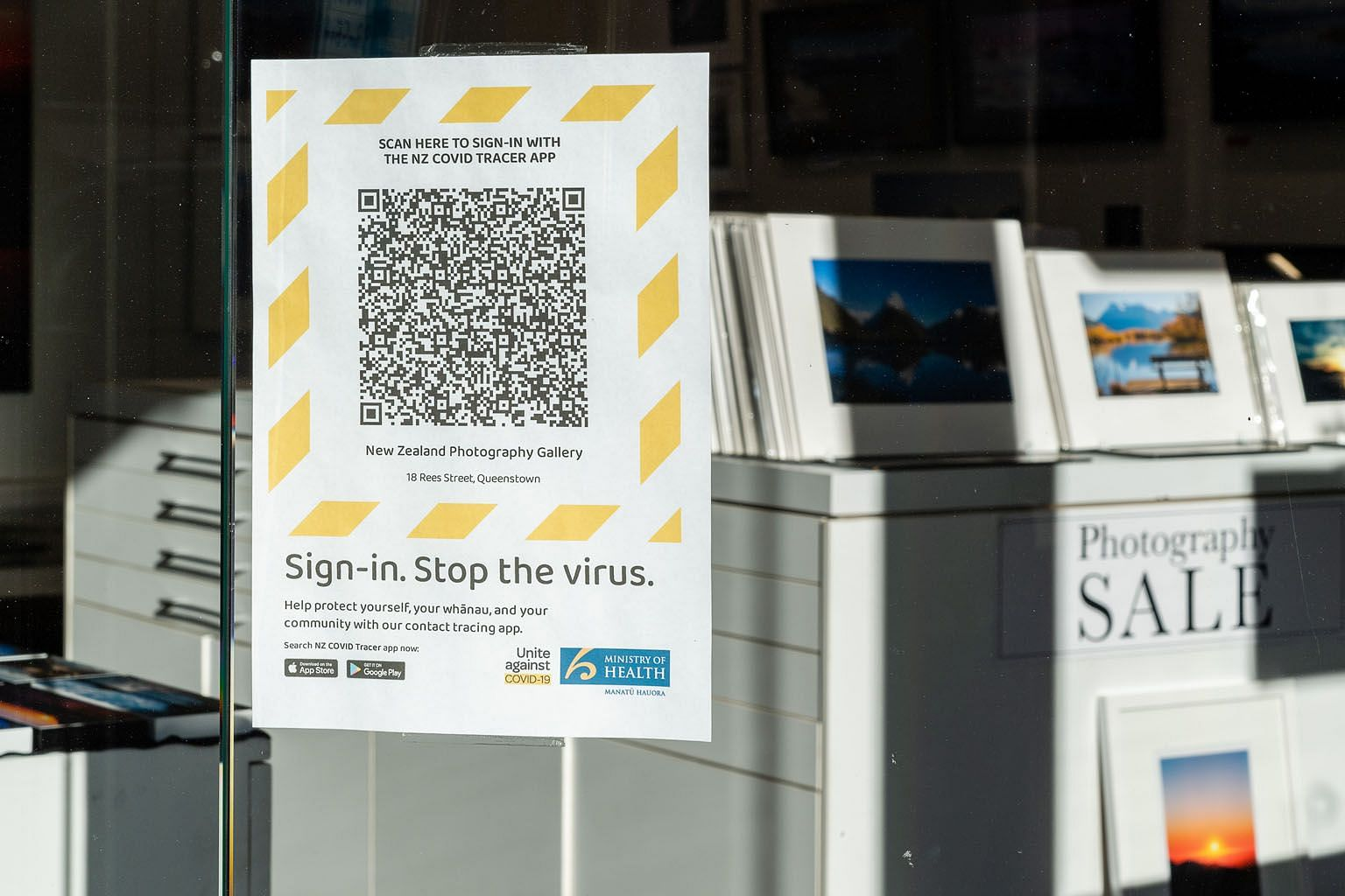 A sign outside a New Zealand shop reminding people to download a QR code for the country's Covid-19 tracing app.