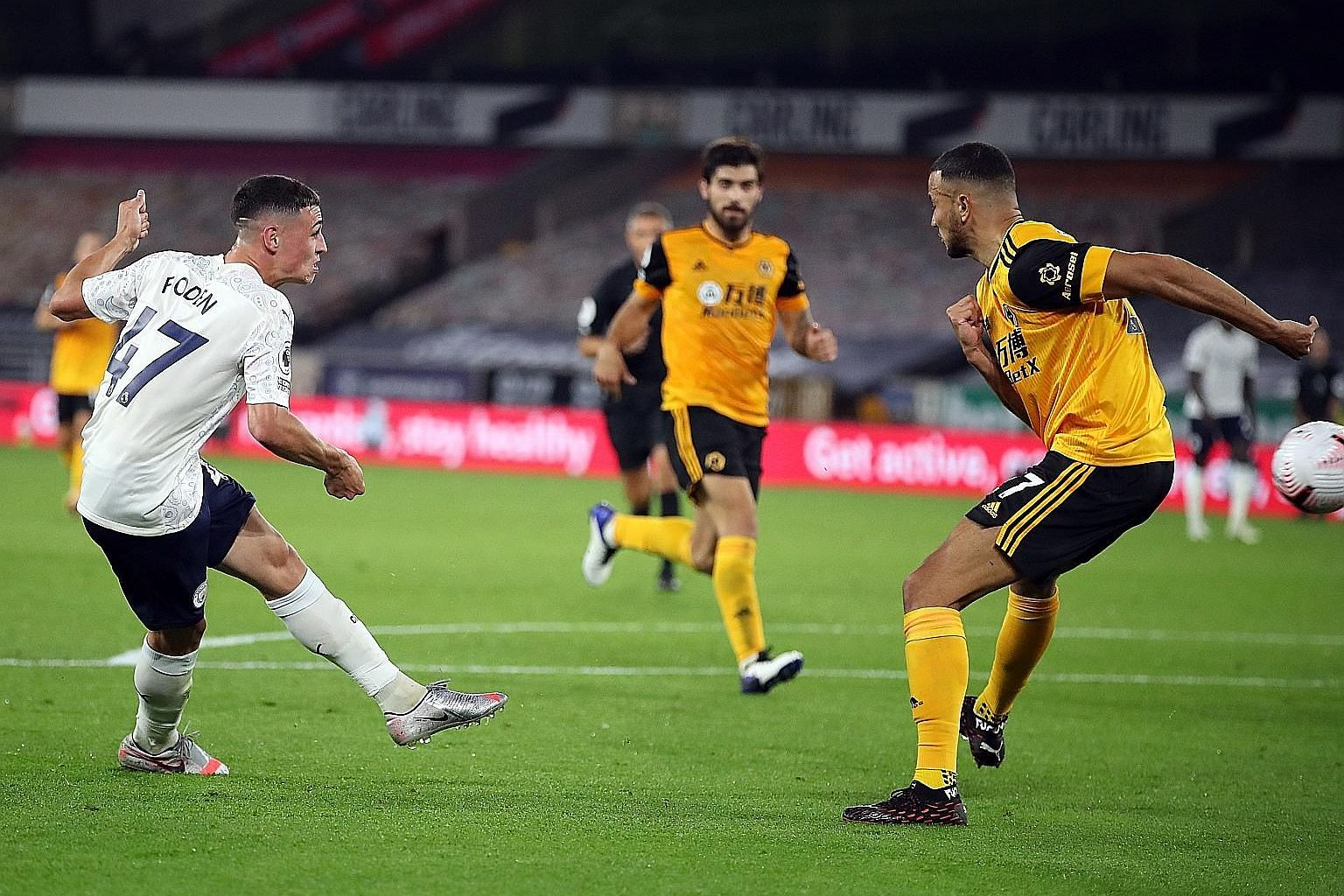 Phil Foden making the score 2-0 for Manchester City against Wolves at the Molineux on Monday. The 3-1 win was City's 10th consecutive Premier League opening-fixture victory. PHOTOS: EPA-EFE