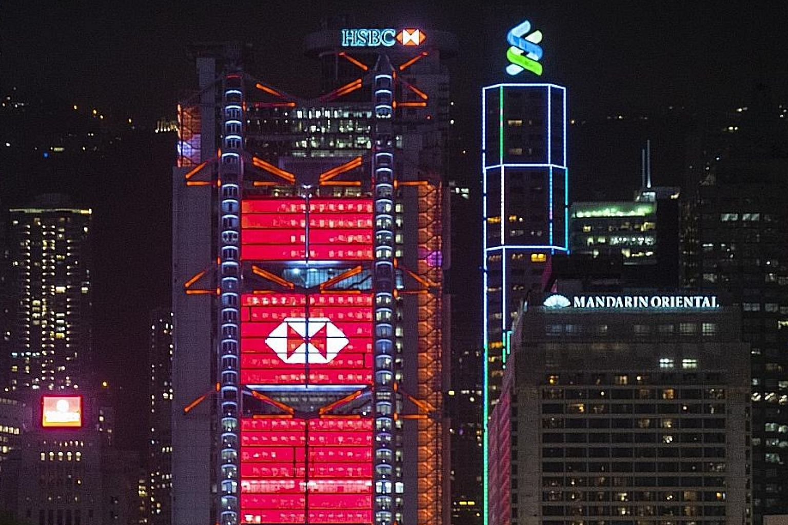 The HSBC and Standard Chartered buildings in Hong Kong. The two banks were among some 90 lenders named in leaked documents that shed light on potentially dubious money transfers worth about US$2 trillion (S$2.7 trillion) between 1999 and 2017. PHOTO:
