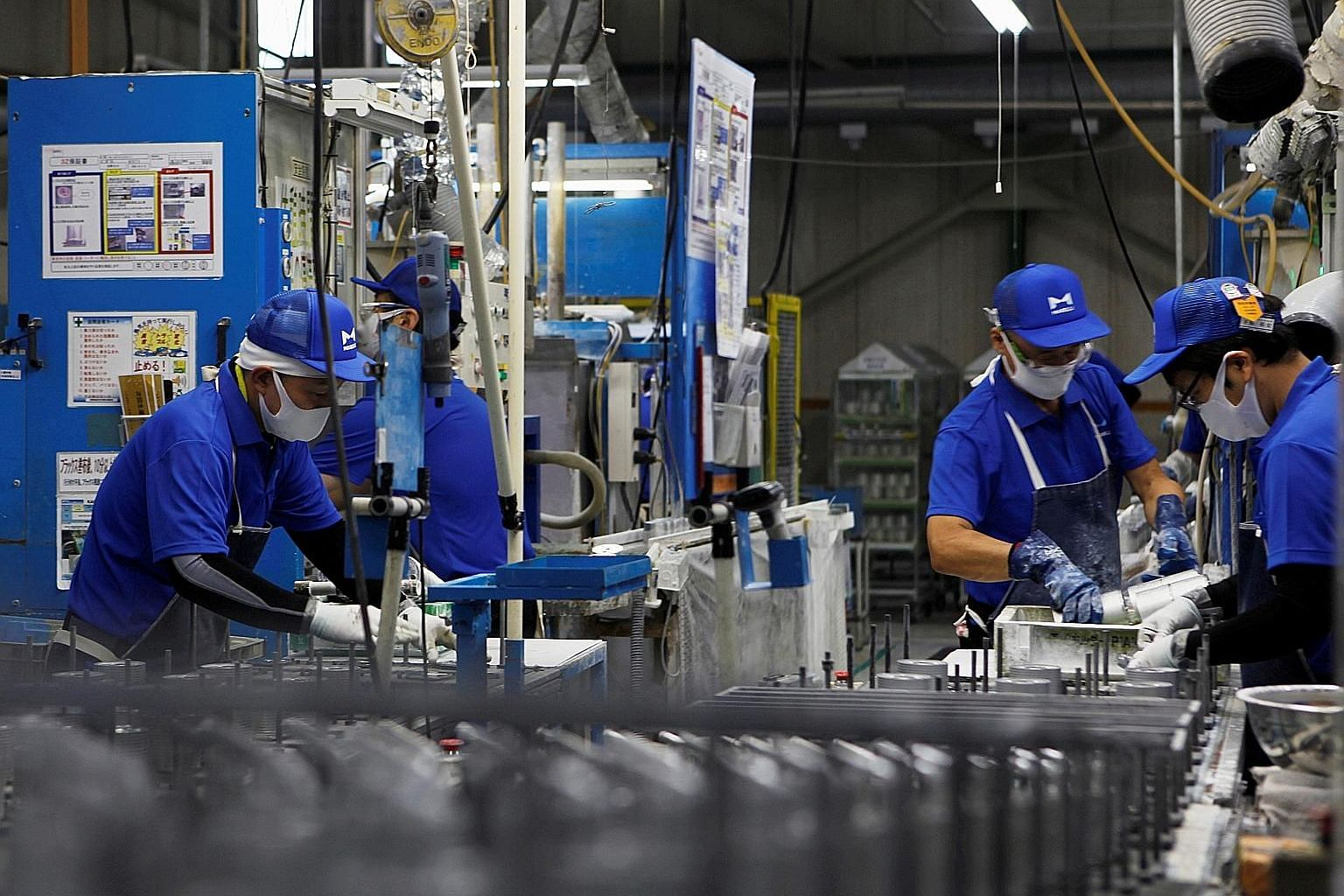 Workers at car-parts maker Marelli's factory in Ora, Gunma prefecture. The survey shows Japan's September factory output contracted at a faster pace for the first time in four months. But while still remaining in contraction, other indicators such as