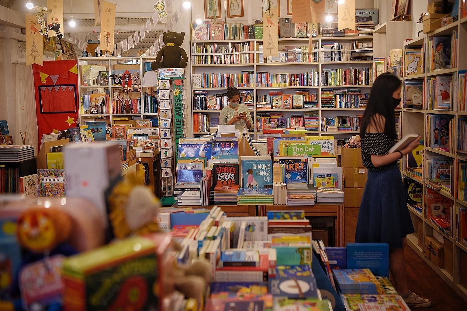 Children's bookstore Woods In The Books (left) in Tiong Bahru was one of the bookstores caught off guard by the circuit breaker. As it had no webstore then, it decided to curate care packs of books and toys to send to customers.