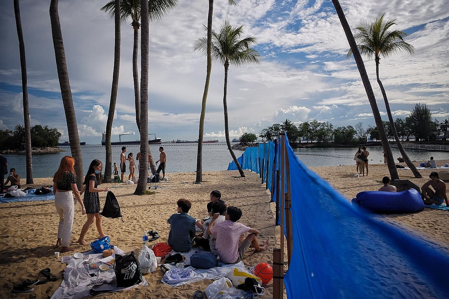 Visitors at Siloso Beach yesterday. The booking system will be trialled for an initial period of three months for Tanjong, Palawan and Siloso beaches. Since July, the three beaches have been segmented into a total of seven zones, each with a capacity