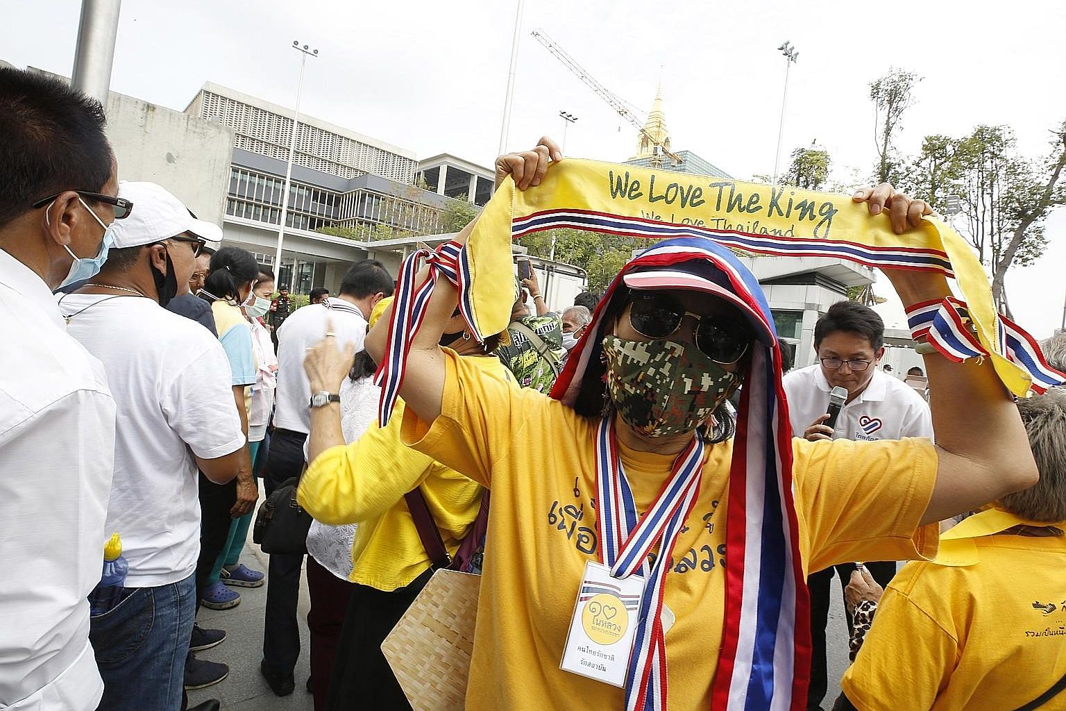 A Thai royalist and pro-government supporter showing support for King Maha Vajiralongkorn during a rally to oppose any amendments to the Constitution outside Parliament House in Bangkok yesterday.