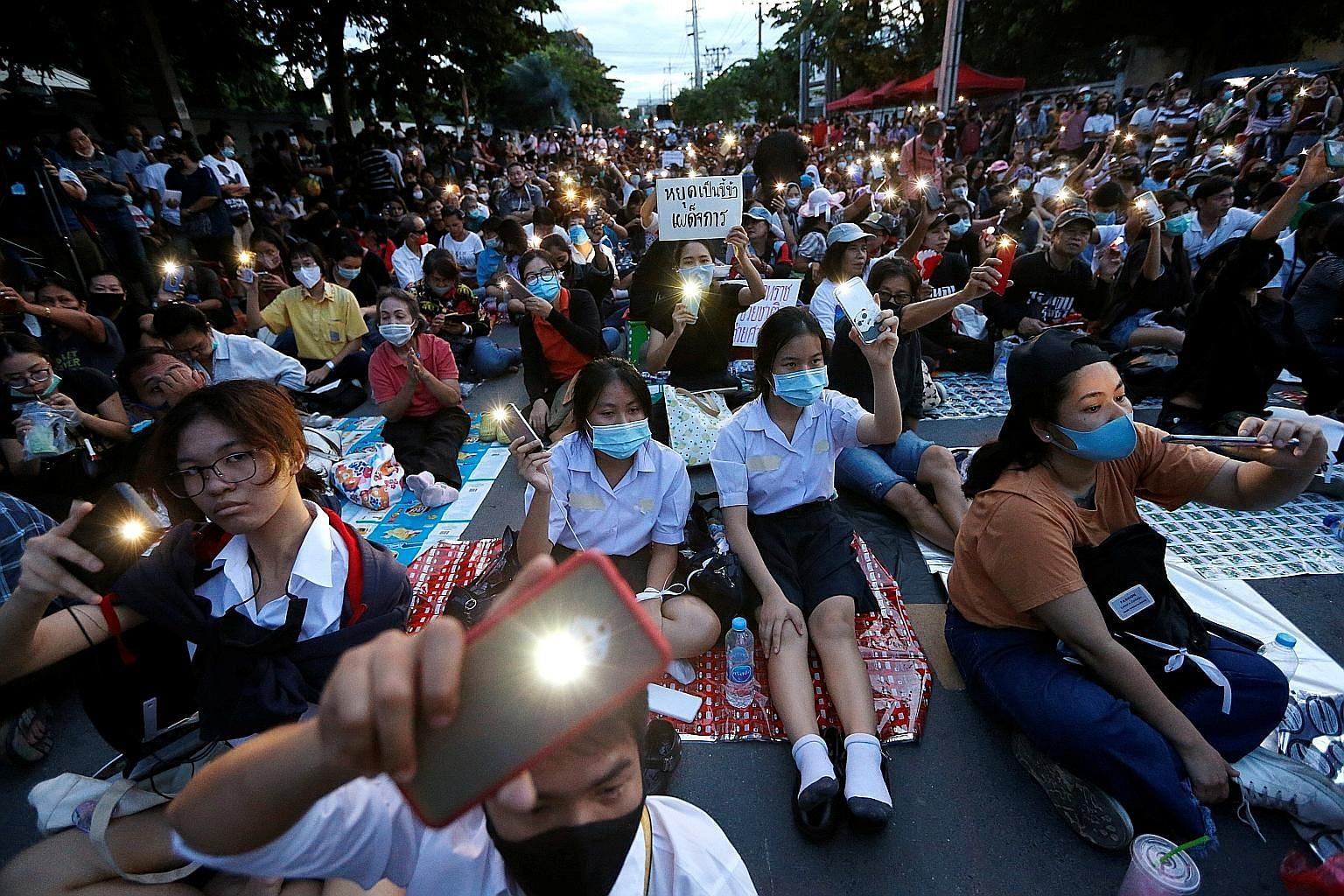 Pro-democracy protesters at a mass rally in front of Parliament in Bangkok yesterday to call for the ouster of Prime Minister Prayut Chan-o-cha and for reforms in the monarchy.