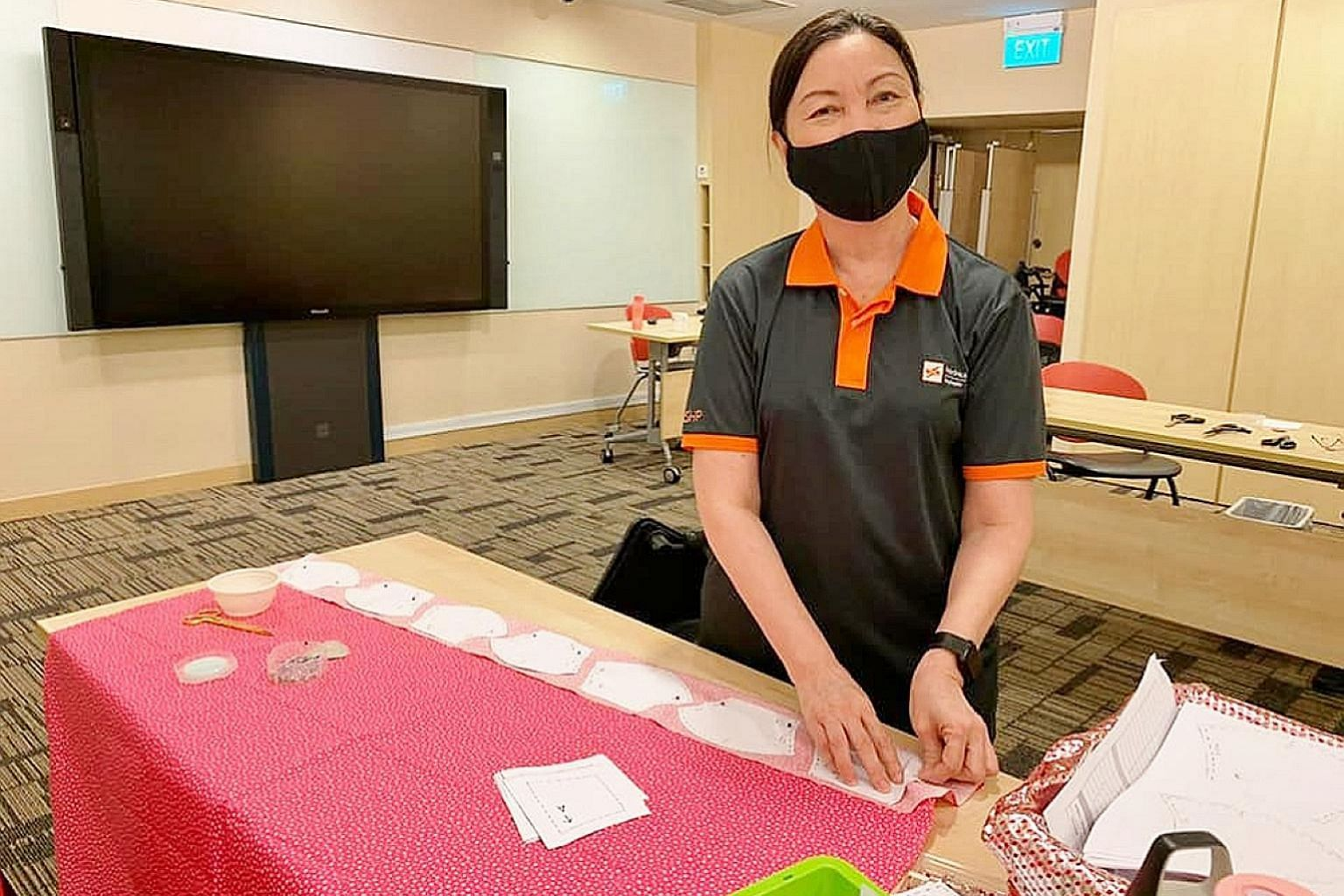 Nurse clinician Ou Lee Hua (above) and senior nurse manager in nursing administration Daisy Tng (left) from SingHealth Polyclinics working on the masks. They were among SHP nurses who assembled and sewed masks to raise money for needy patients.
