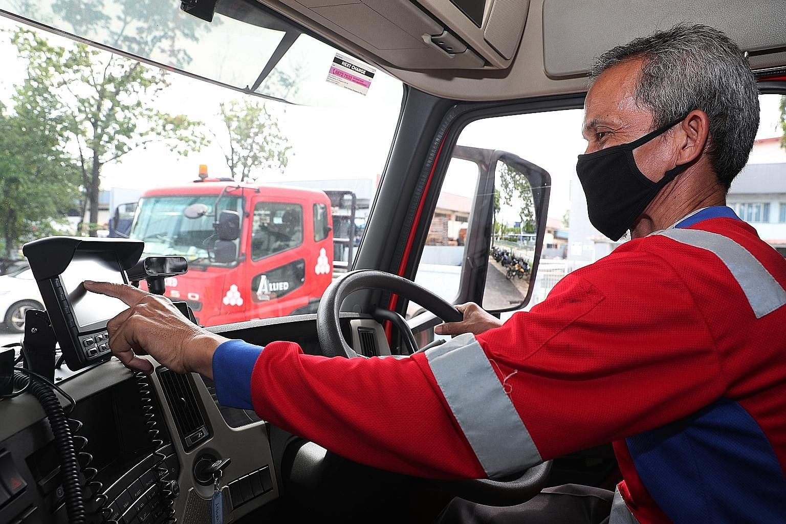 The system uses facial recognition technology to detect signs of fatigue, such as yawning, and then alerts an operations team which will check on the driver. Prime mover driver Mohamed Ali, 57, with Allied Container Services demonstrating the use of
