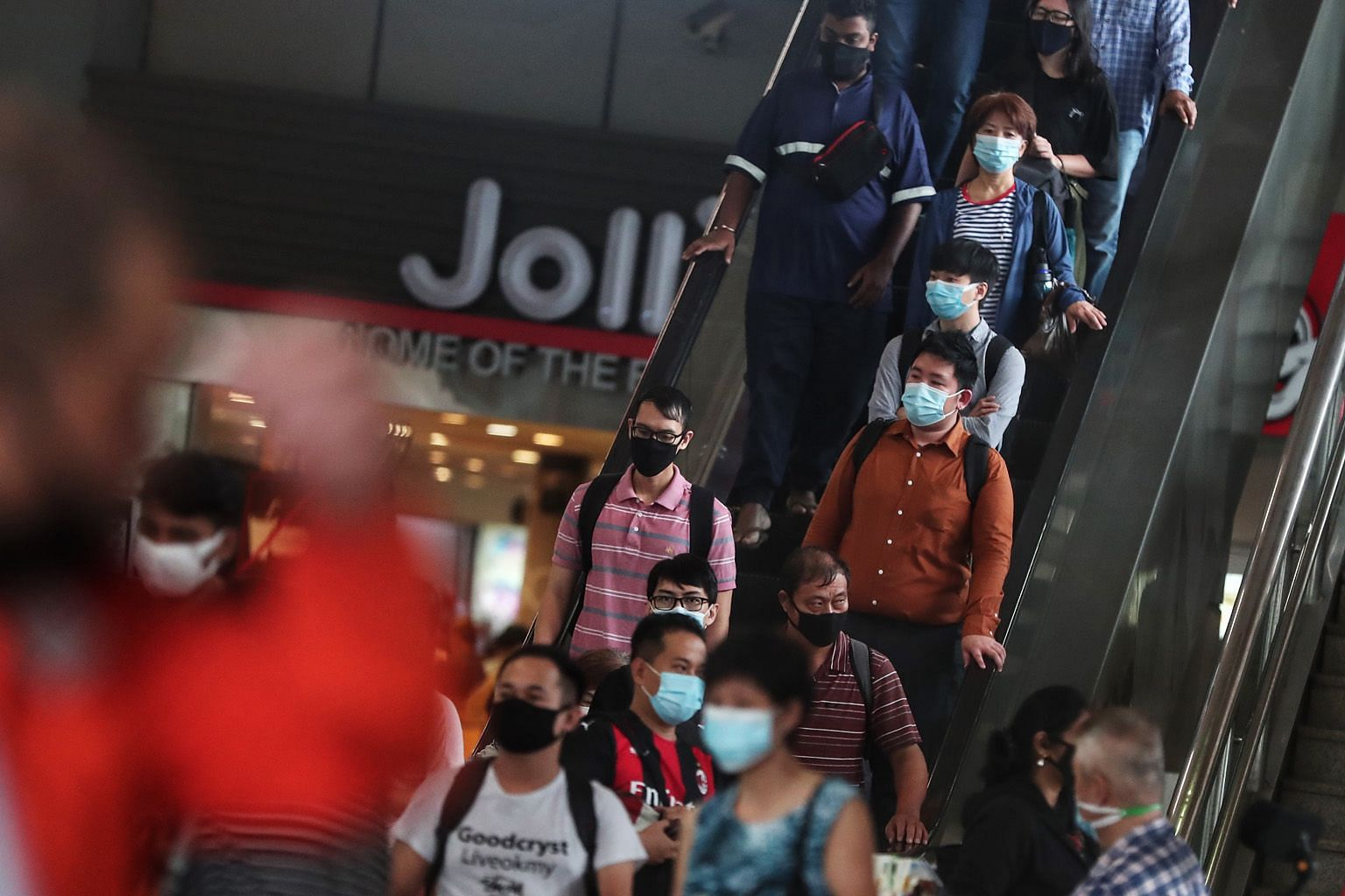 Despite everything we have endured in the fight against Covid-19, the end is still far away, with mask wearing continuing to be the norm and the economy taking a severe hit. And a vaccine is not the endgame. ST PHOTO: KELVIN CHNG