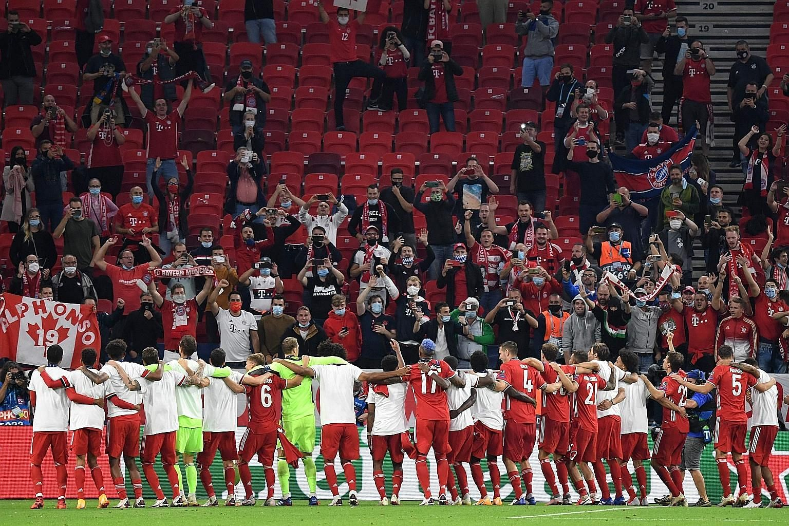 Bayern Munich players celebrating with their supporters after beating Sevilla 2-1 in extra time to win the Uefa Super Cup in Budapest, Hungary, on Thursday.