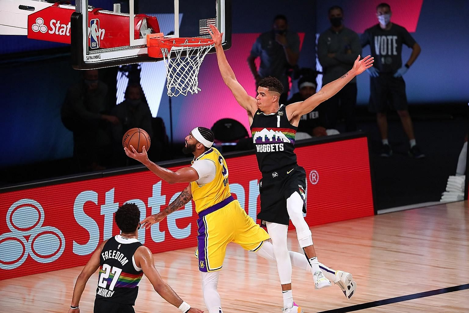 Los Angeles Lakers' Anthony Davis shooting past Denver Nuggets' Michael Porter Jr during Game 4 of the NBA's Western Conference Finals series at the AdventHealth Arena. Davis combined with LeBron James for 60 points.