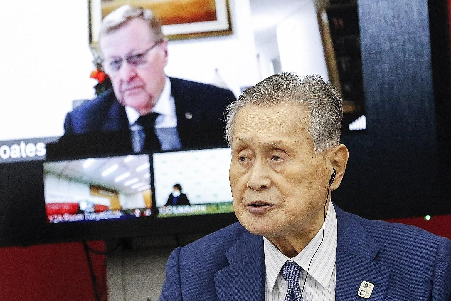 Tokyo Games Committee president Yoshiro Mori and IOC vice-president John Coates attending a press conference in Tokyo yesterday. Officials and organisers have agreed on over 50 cost-cutting measures.