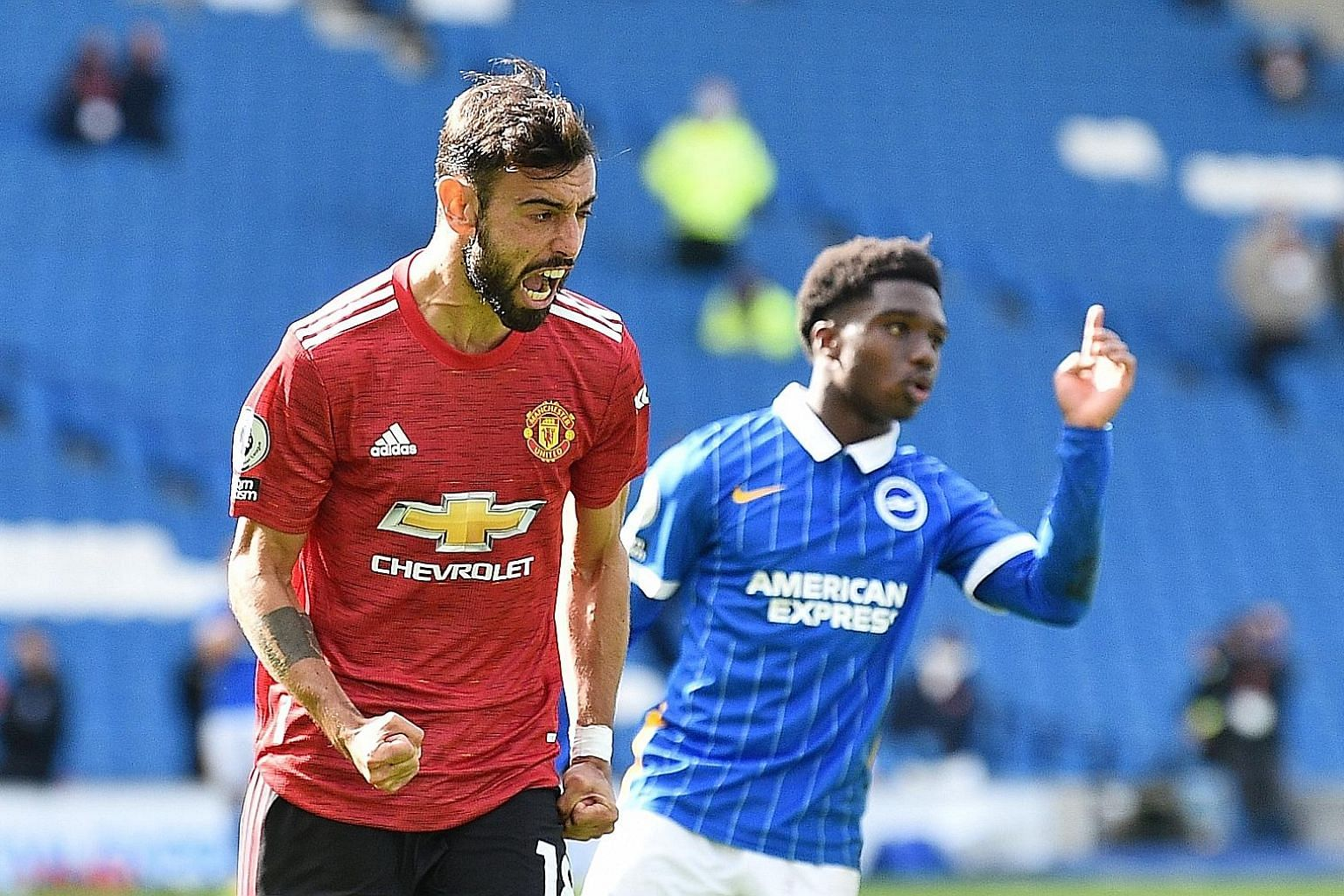 Bruno Fernandes celebrating after scoring Manchester United's third goal at Brighton yesterday. It was the 18th straight penalty that the Portuguese has converted. PHOTO: REUTERS