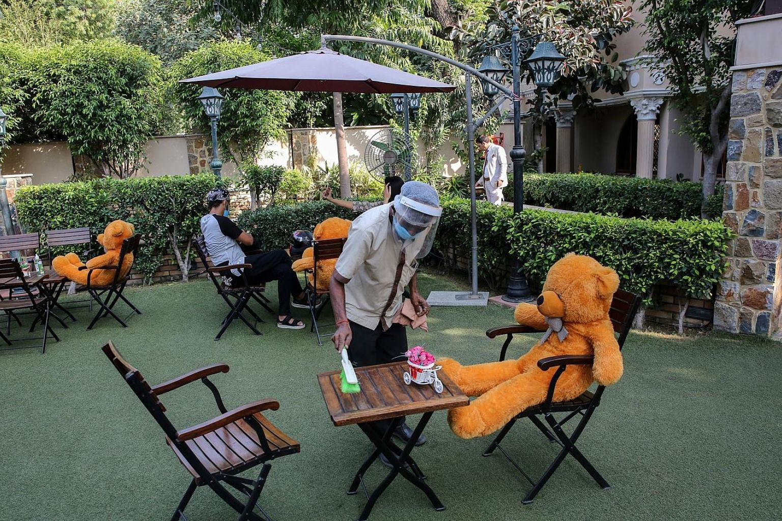 Teddy bears placed to encourage social distancing at Rustique cafe in New Delhi on Friday. The last 24 hours up to Saturday saw 85,362 new infections in India, taking the total past 5.9 million cases. PHOTO: EPA-EFE