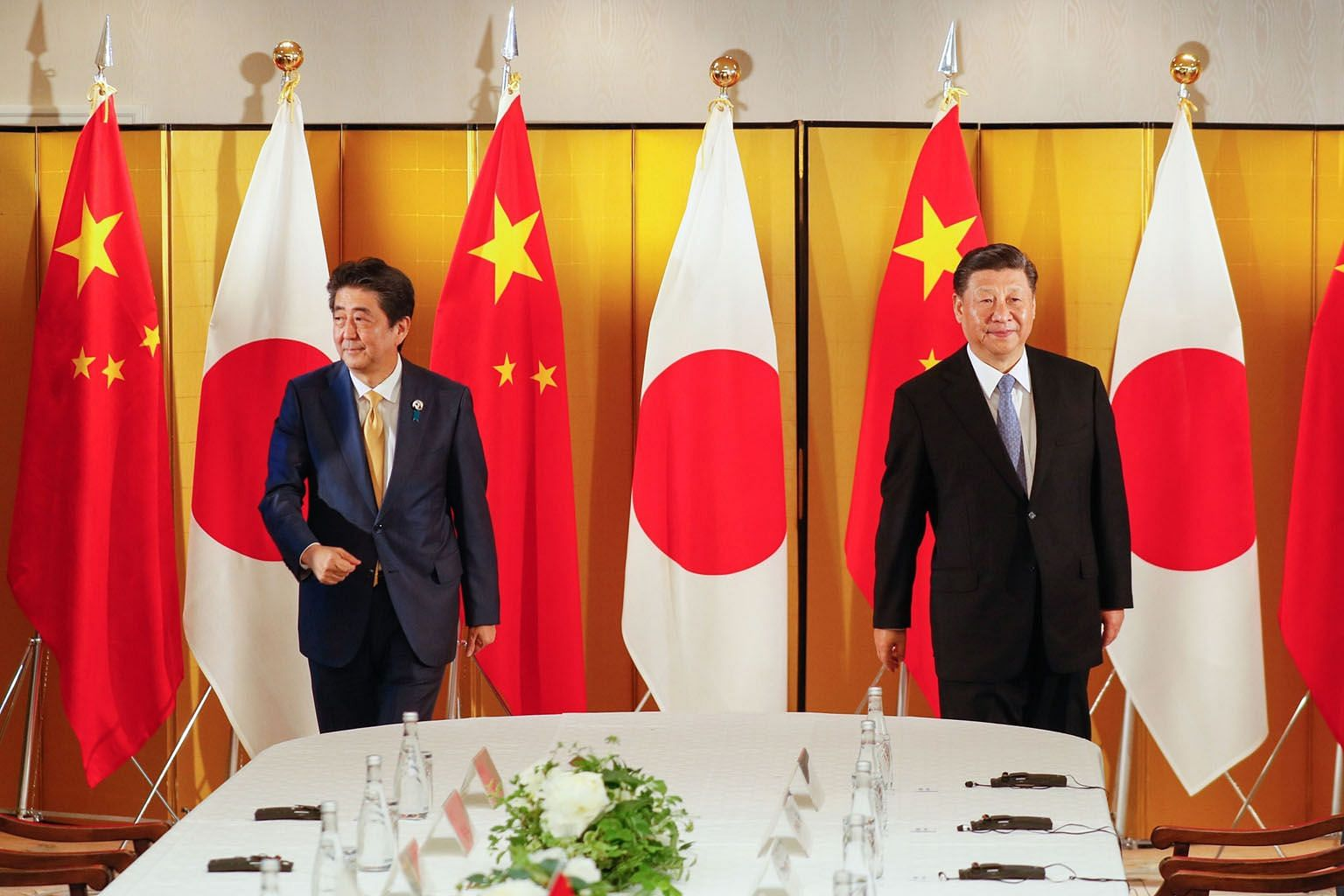"""Japan's then Prime Minister Shinzo Abe (left) and Chinese President Xi Jinping at a bilateral meeting ahead of the Group of 20 summit in Osaka last year. In 2007, Mr Abe, with an eye on China, had proposed an """"Arc of Democracy"""" as a loose alliance of"""