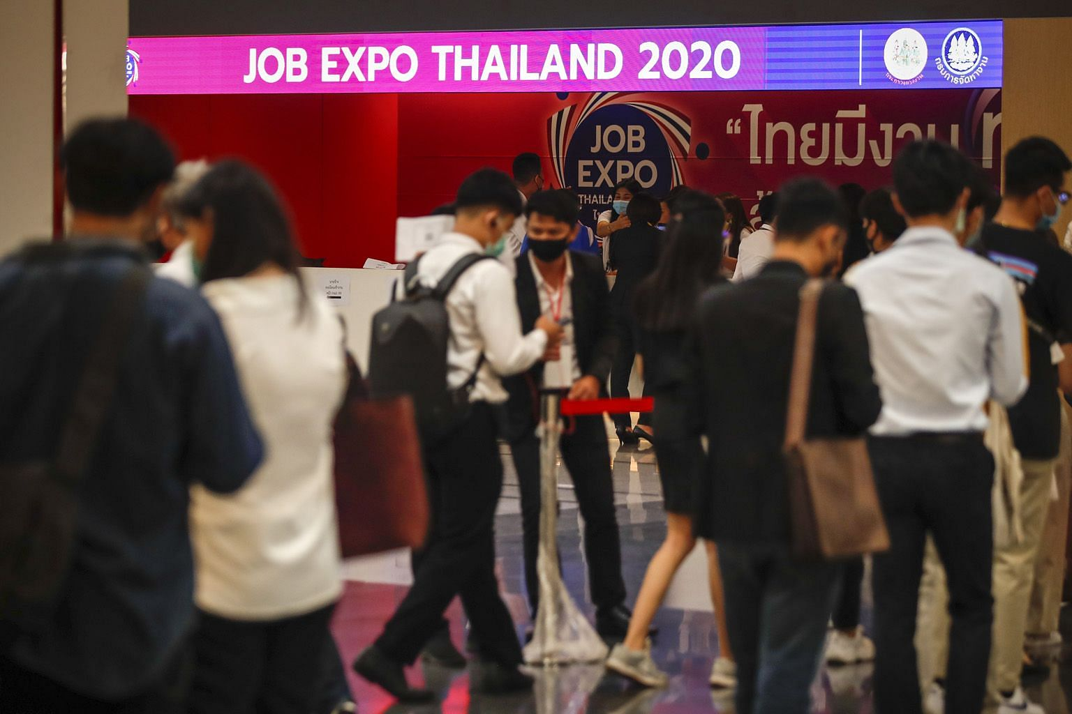 Thais waiting to enter the Job Expo Thailand 2020 in Bangkok last Saturday. South-east Asia's second-largest economy could shrink by a record 8.5 per cent this year, with its key tourism sector taking a severe beating, the government predicts, leavin