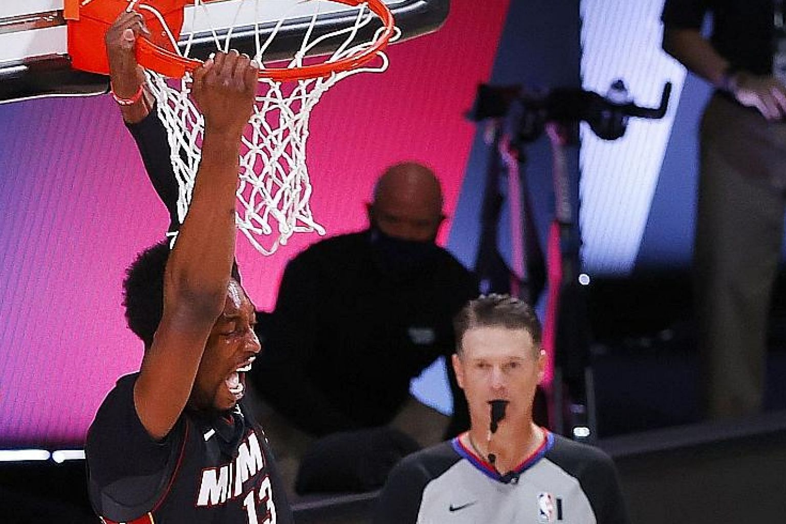 Miami's Bam Adebayo dunking the ball over Boston's Kemba Walker in Game Six of the Eastern Conference Finals on Sunday. He had a career-high 32 points and 14 rebounds in the 125-113 win, which gave his team a 4-2 series success and a place in the NBA