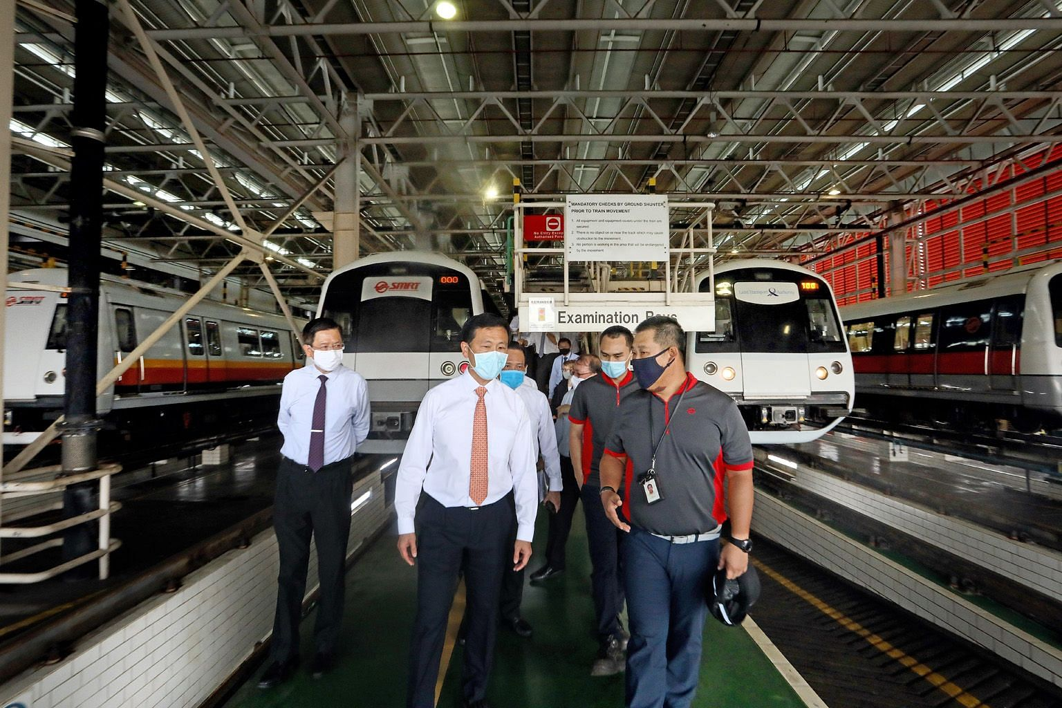 Mr Ong Ye Kung getting a virtual look at the interior of the new North-South and East-West line trains. New features include more open spaces for strollers. Minister for Transport Ong Ye Kung speaking to rail workers at the Bishan train depot yesterd