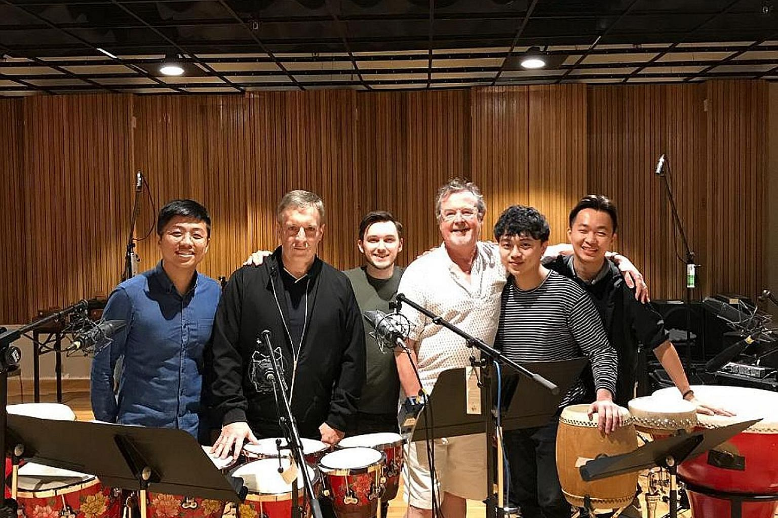 (From far left) Cheong Kah Yiong, Karma Studios owner Chris Craker, composers Alex Lamy and Richard Harvey, Derek Koh and Low Yik Hang. Cheong, Koh and Low are among the members of Ding Yi Music Company who recorded music for Disney's Mulan.