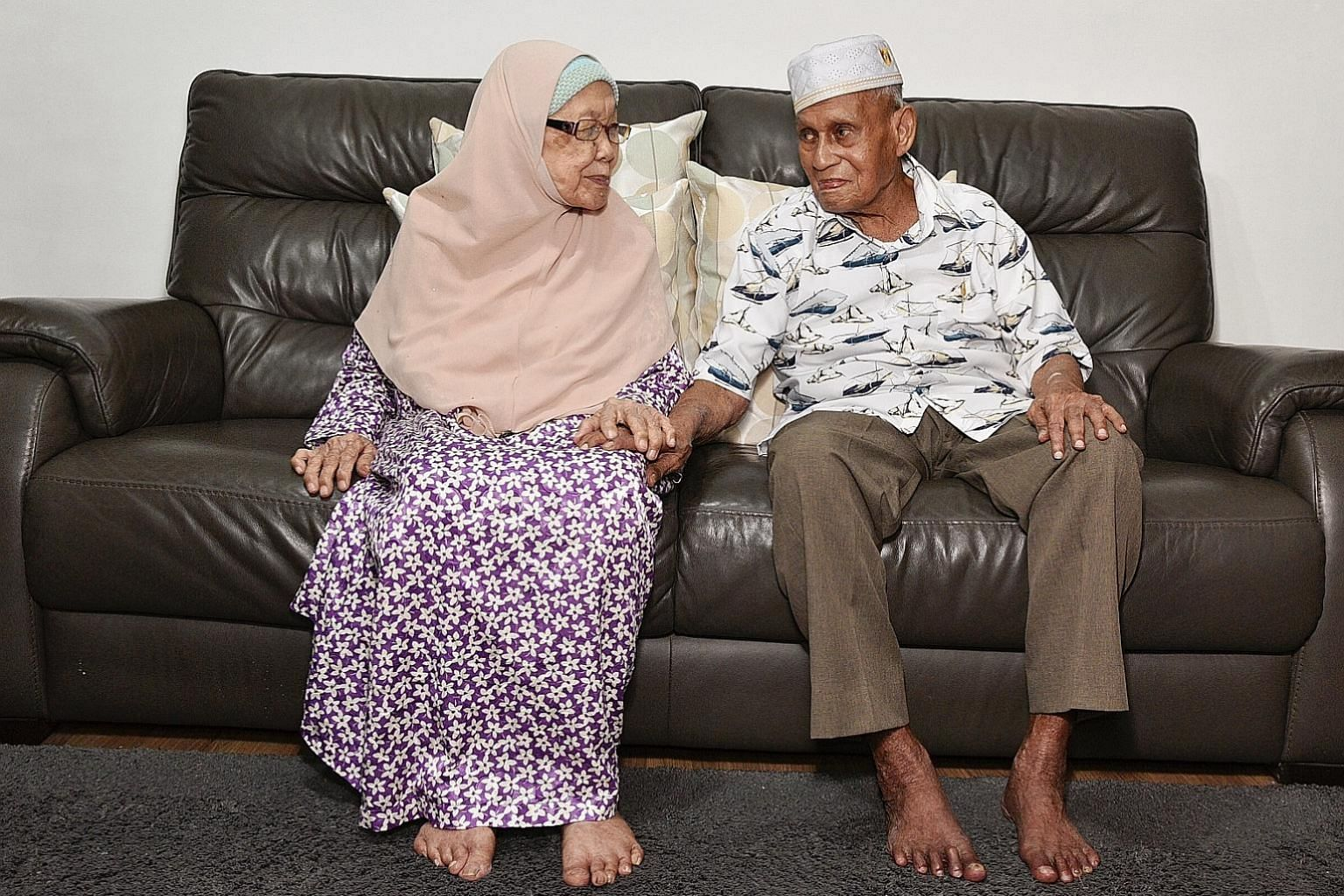 Centenarian Kassim Sultan, pictured above with his wife, Madam Tuminah Haji Siraj, 90, is among the 20,900 Singapore residents aged 90 and older as at June this year, a 94 per cent jump from the 10,800 people in this age group a decade ago. ST PHOTO: