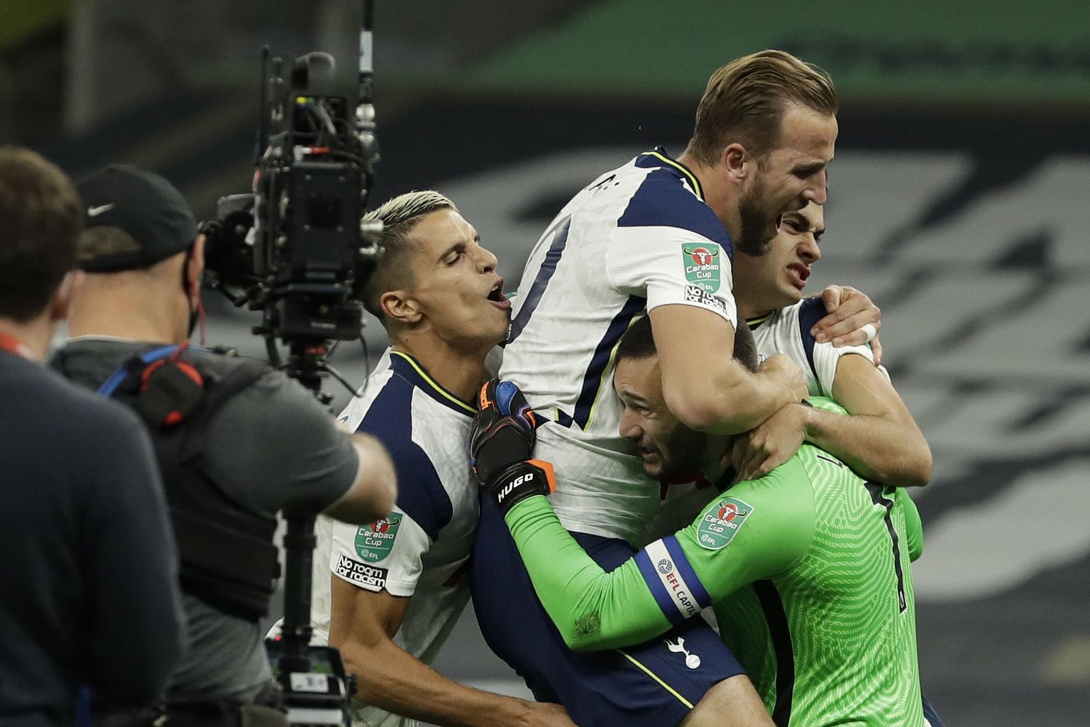 Top: Tottenham's Harry Kane and other players jumping on goalkeeper Hugo Lloris after their 5-4 penalty shoot-out win over Chelsea at home. Above: Mason Mount's penalty beating Lloris but clipping the post to put Spurs through to the League Cup quart