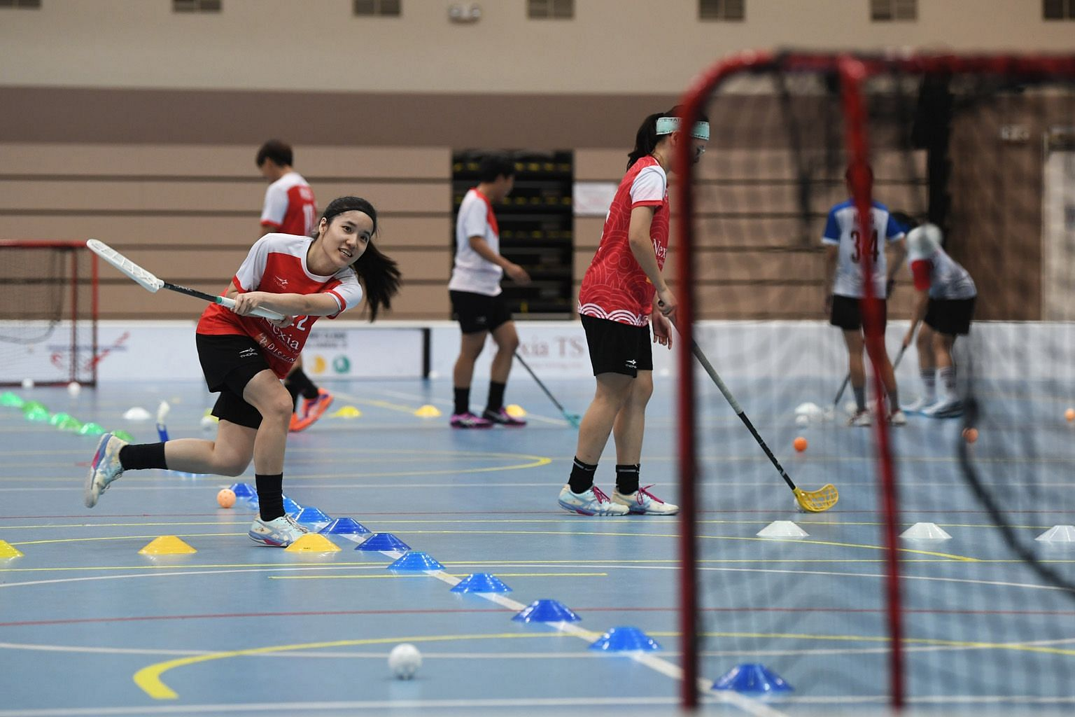 Two-time SEA Games gold medallist Amanda Yeap practising shooting at floorball training. Most sportsmen are still restricted to working out in small groups. ST PHOTO: KHALID BABA
