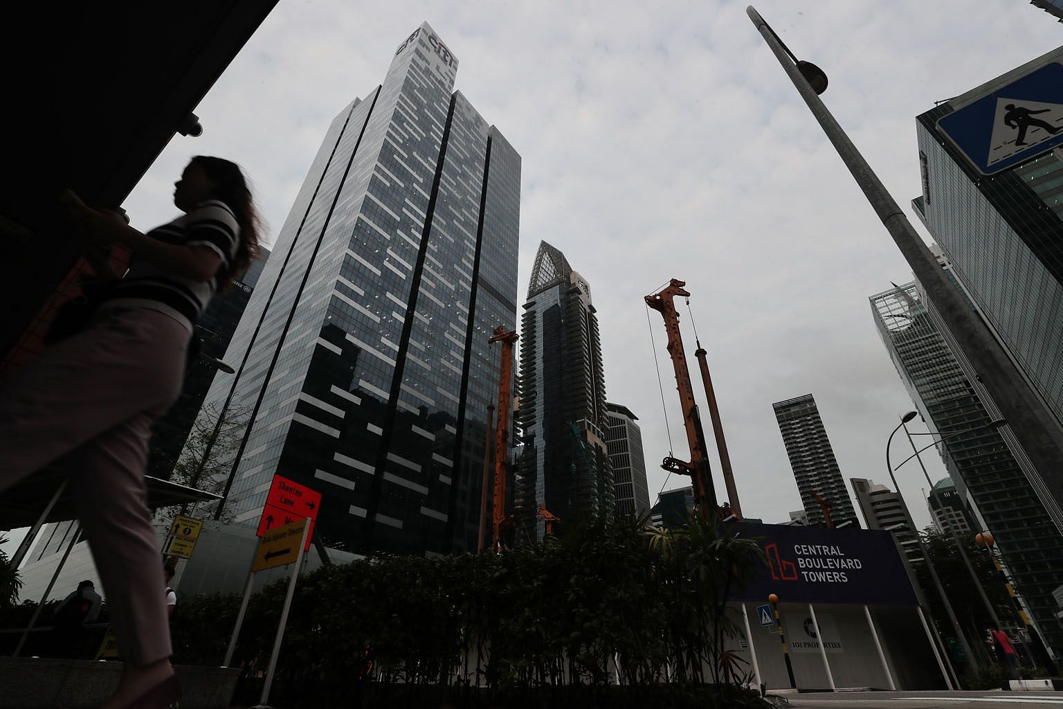 Amazon will lease three floors at Asia Square Tower 1 (left), sources say. Citigroup is currently the largest tenant there with nine floors. ST PHOTO: KELVIN CHNG