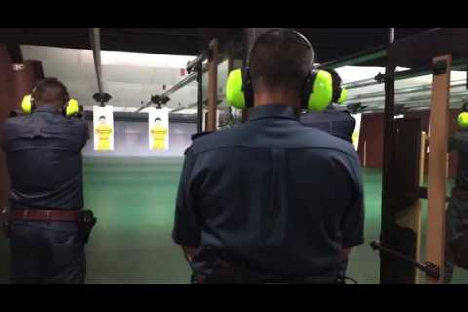 Live-firing training at the Certis Cisco indoor shooting range