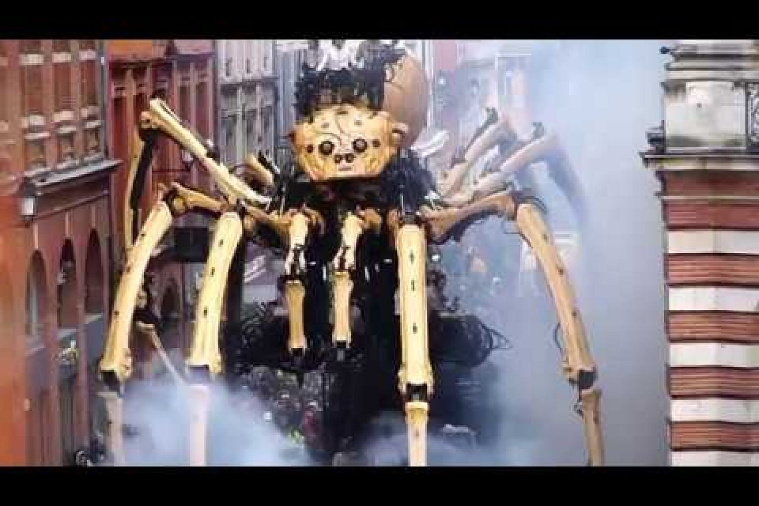 Giant mechanical creatures delight spectators as they roam central Toulouse