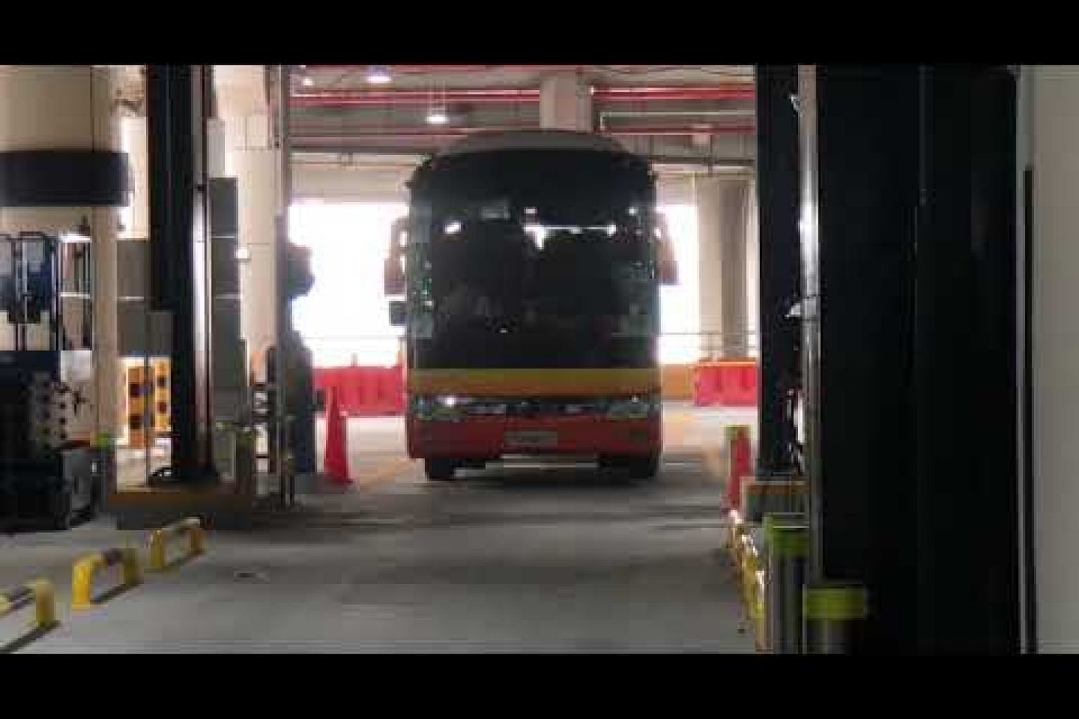Bus drivers going through a new scanning system at Tuas Checkpoint