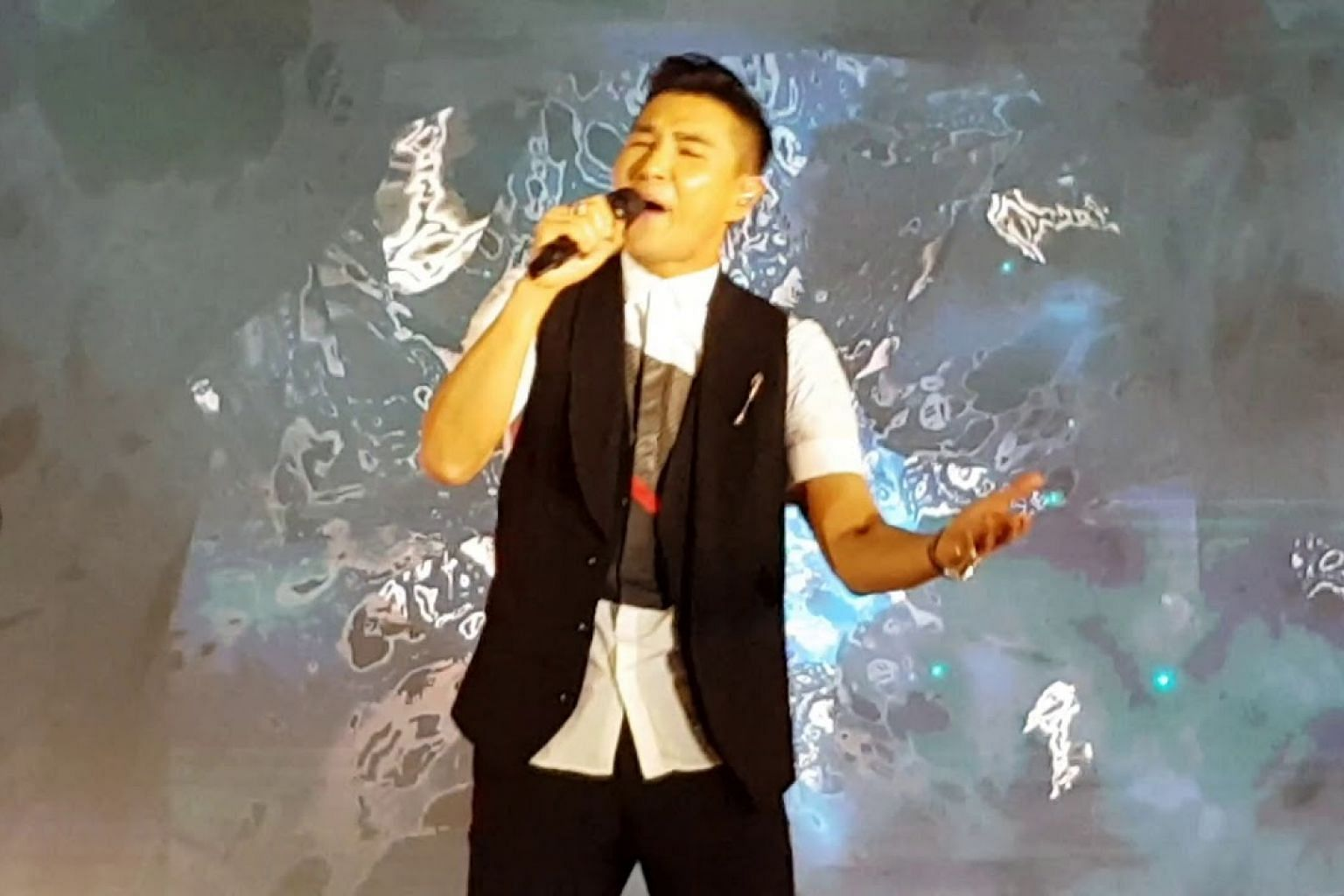 Ruco Chan performs at Ngee Ann City Civic Plaza