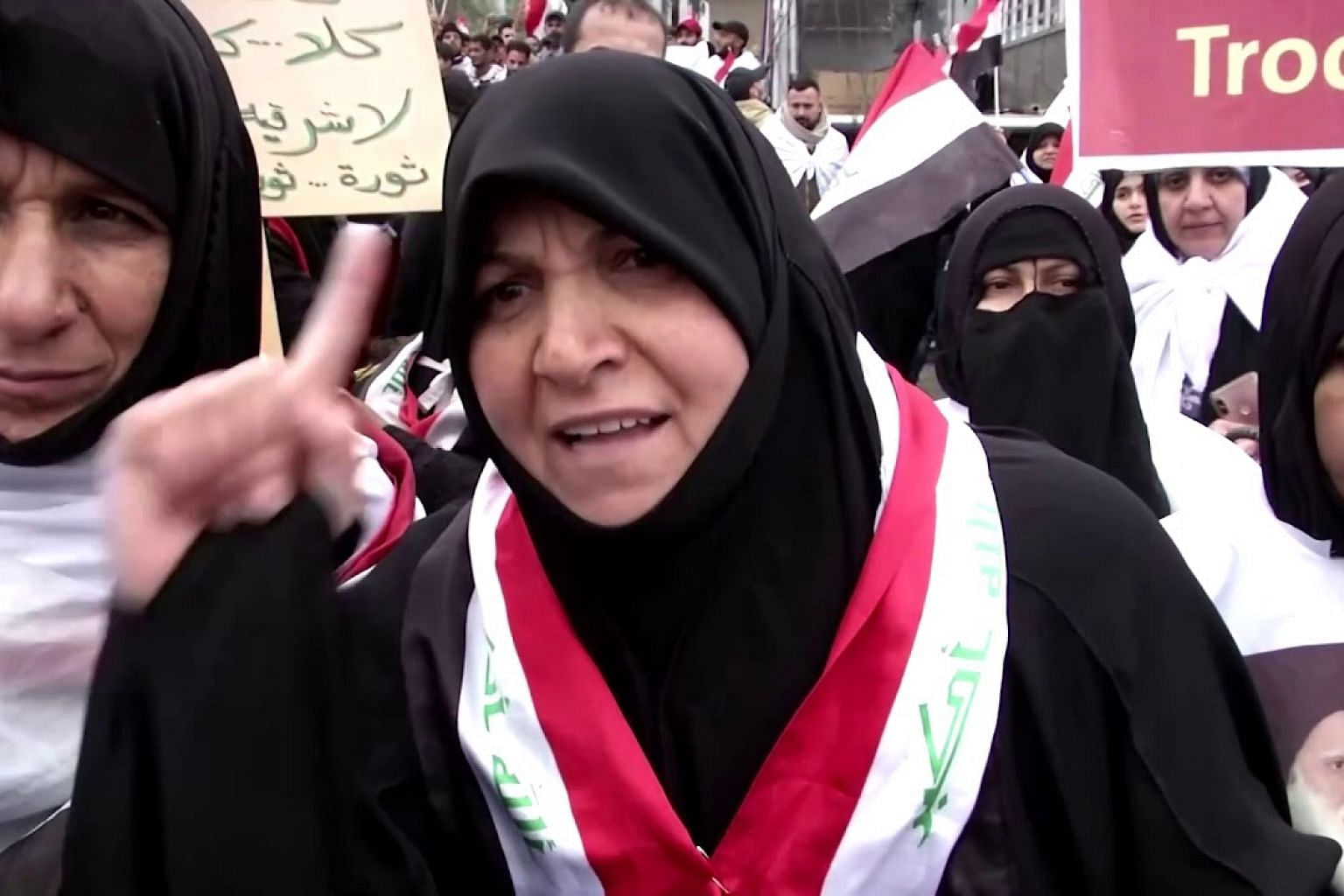 'No to America': Thousands of Iraqis rally against US military presence