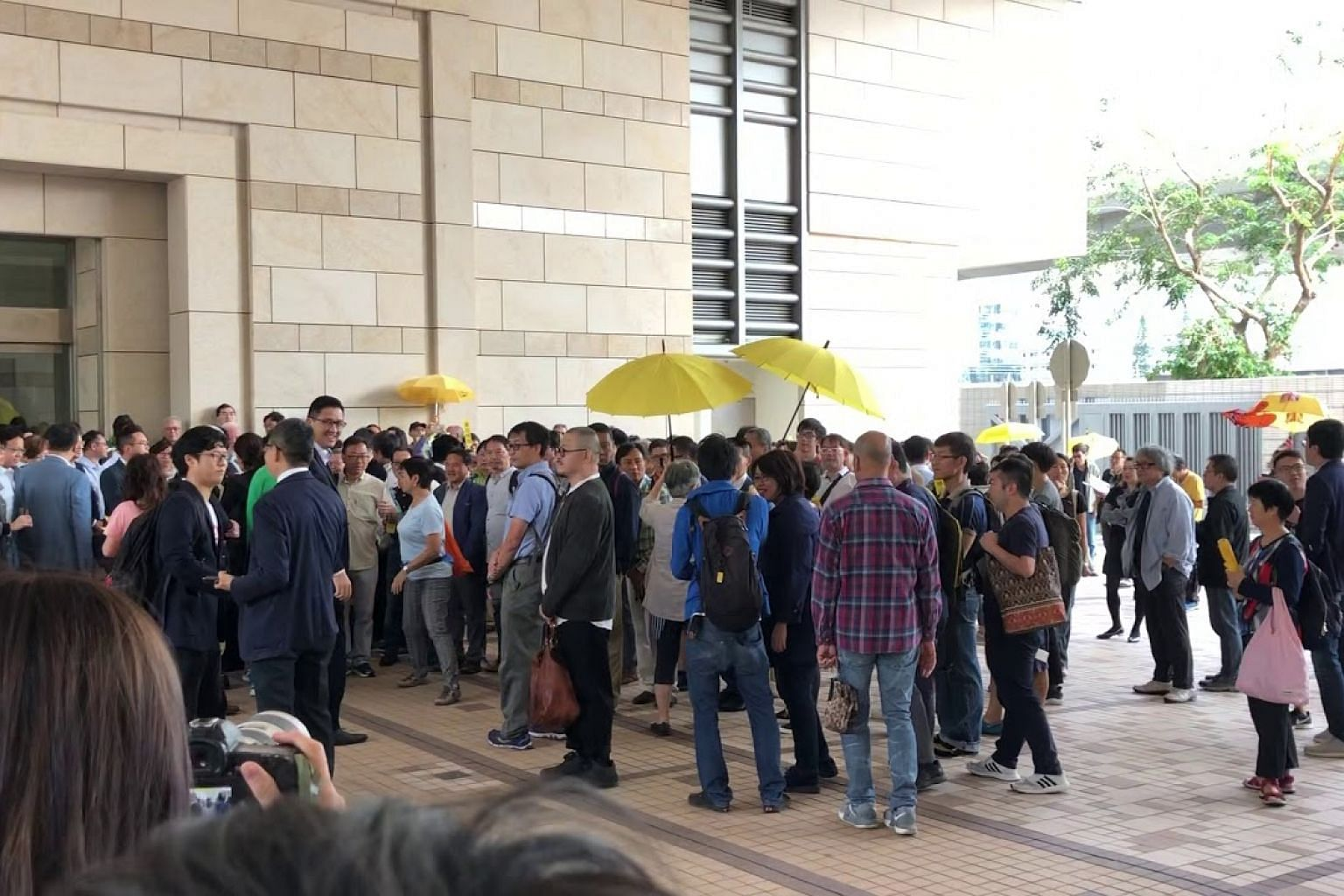 Supporters of Hong Kong democracy leaders outside court before opening of trial