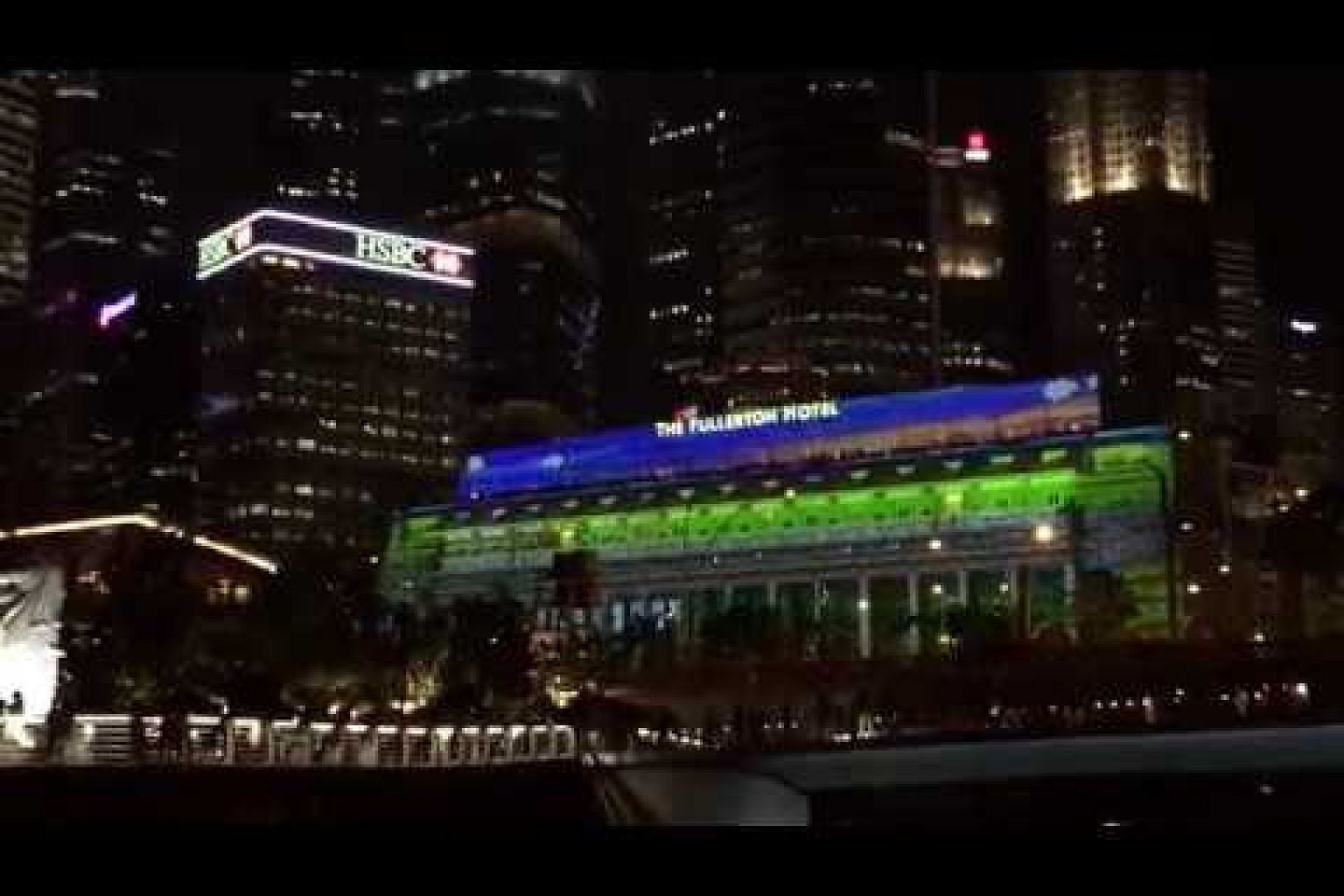 A light projection show on the facade of The Fullerton Hotel Singapore
