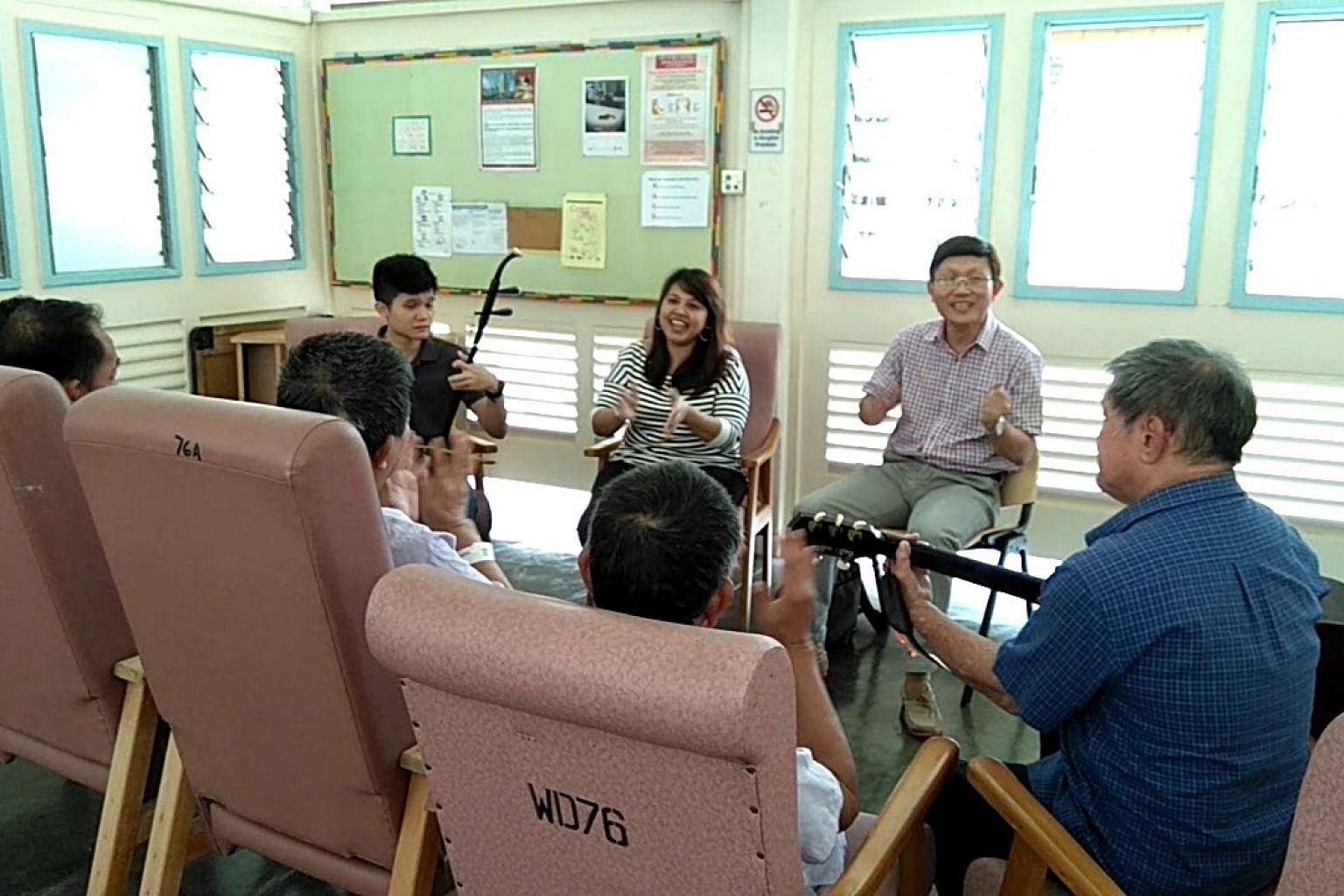 Volunteers singing with TB patients at Tan Tock Seng Hospital