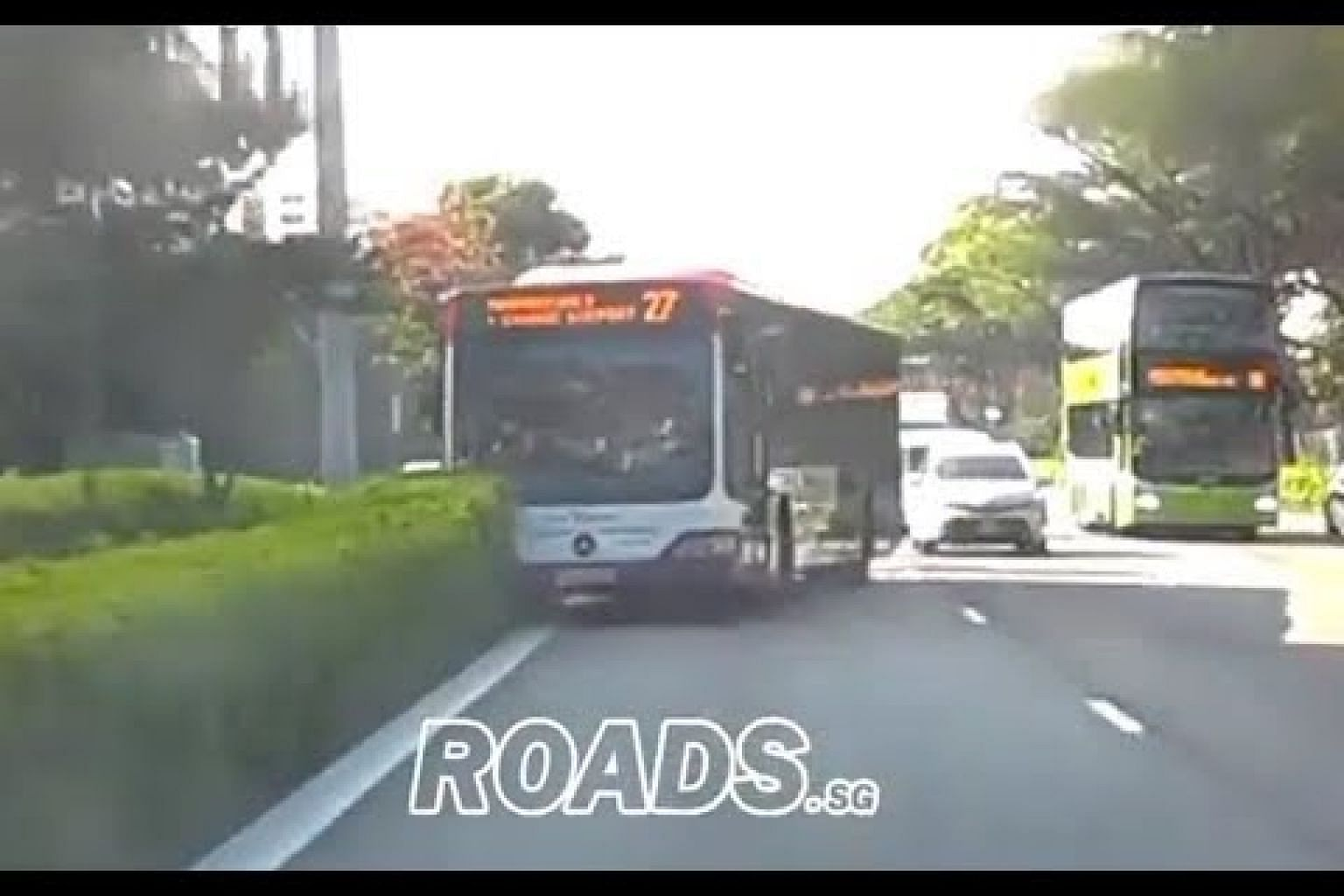 SBS bus veers into central divider on TPE
