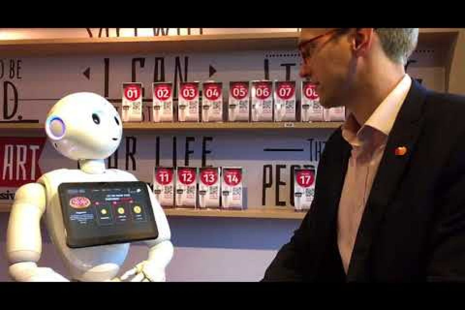 Mr Tobias Puehse orders a pizza from a humanoid robot