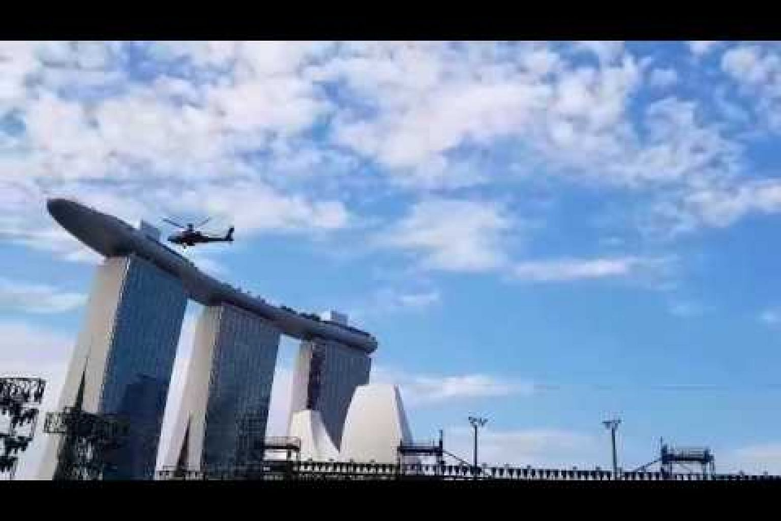 Apache helicopters doing a flyby at the Marina Bay Floating Platform