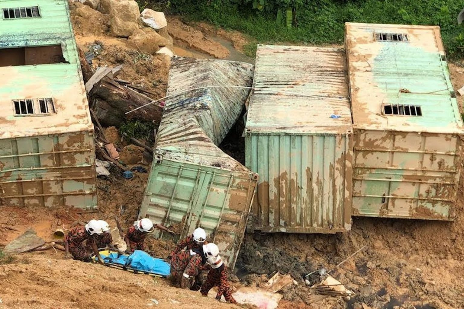 Three dead, 12 missing in Penang landslide