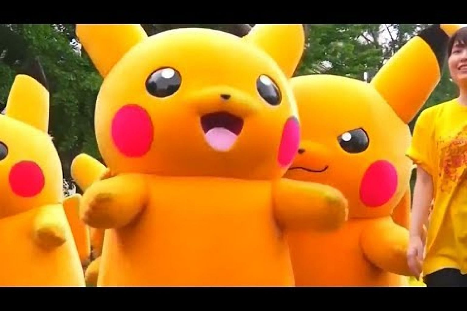 More than 100 Pikachus parade in Japan as fans cheer on