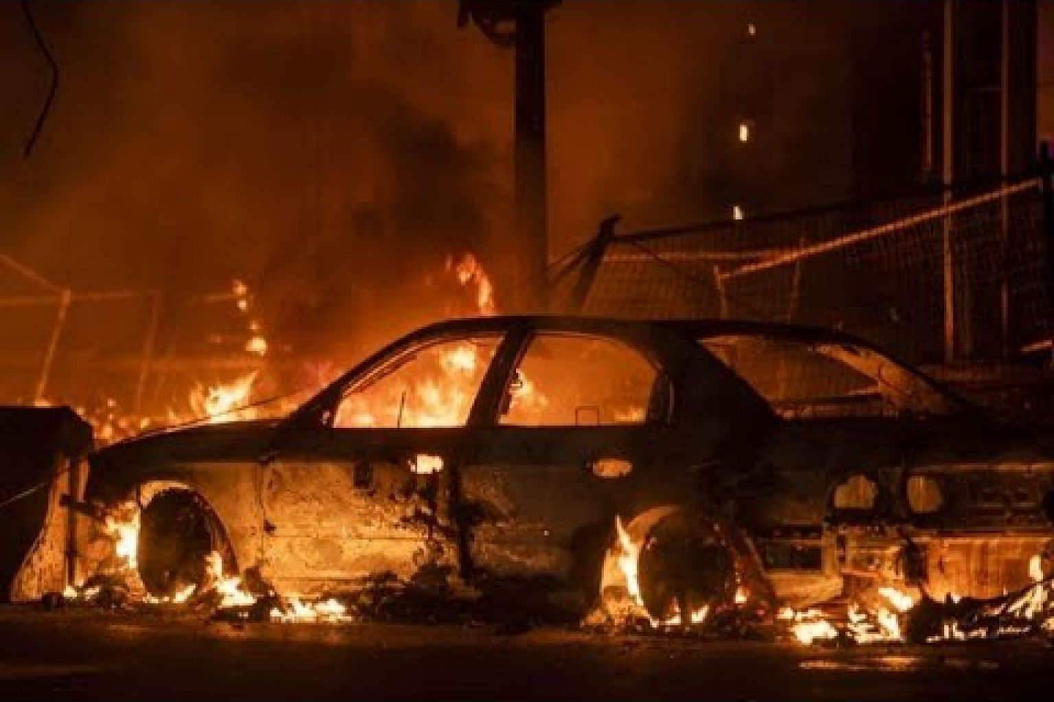 Looting, fire erupts in Minneapolis over racially charged killing by police