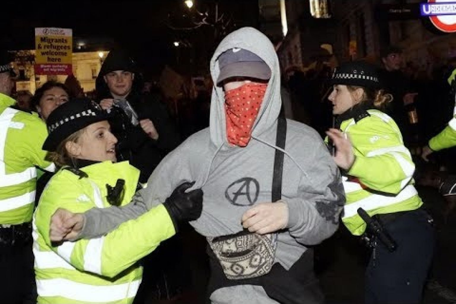 Police, protesters clash in London march against Johnson