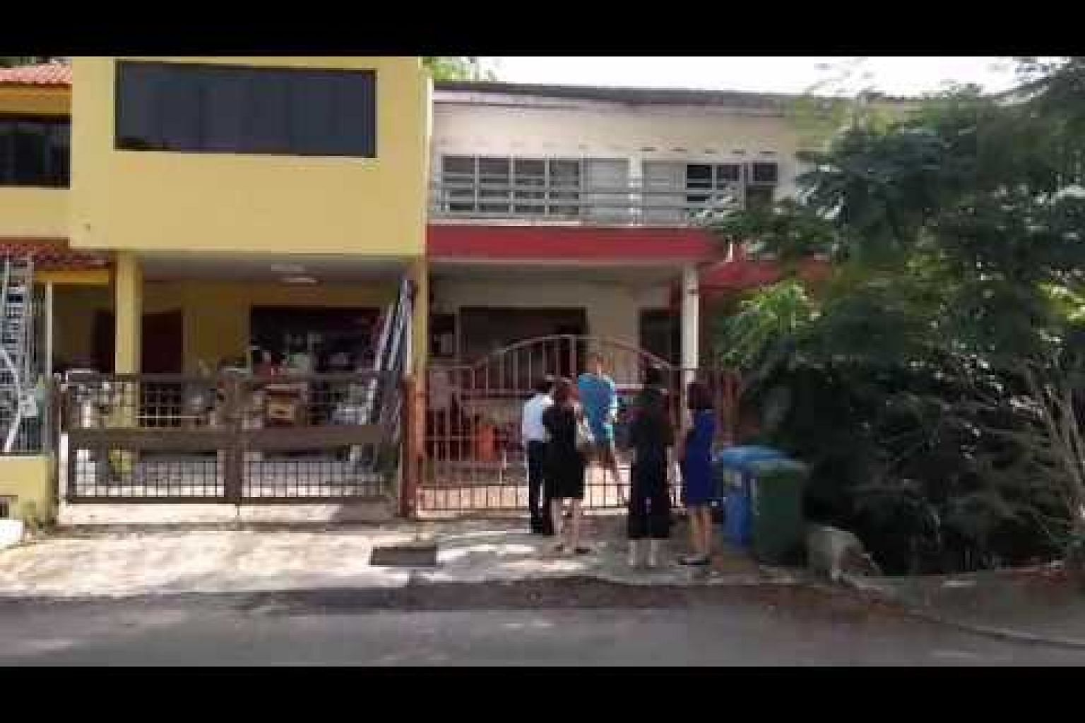 SLA officers serving notice to one of the three landed houses at Merpati Road