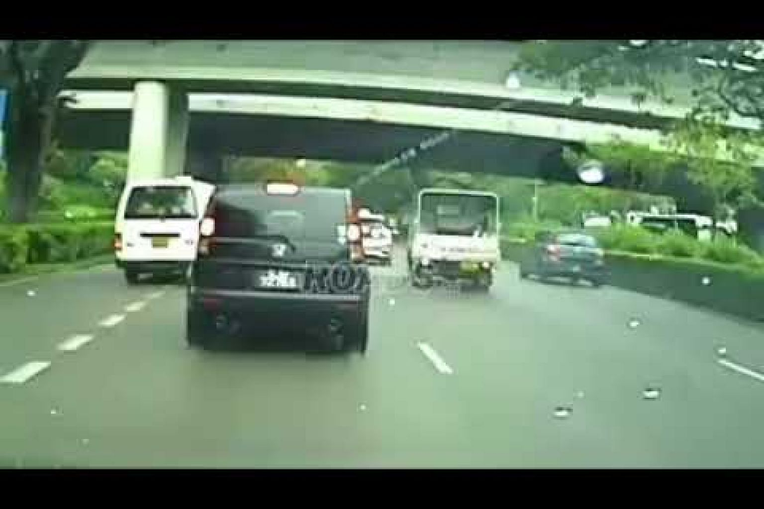 Lorry skids on wet road along PIE, hits car before crashing into barriers