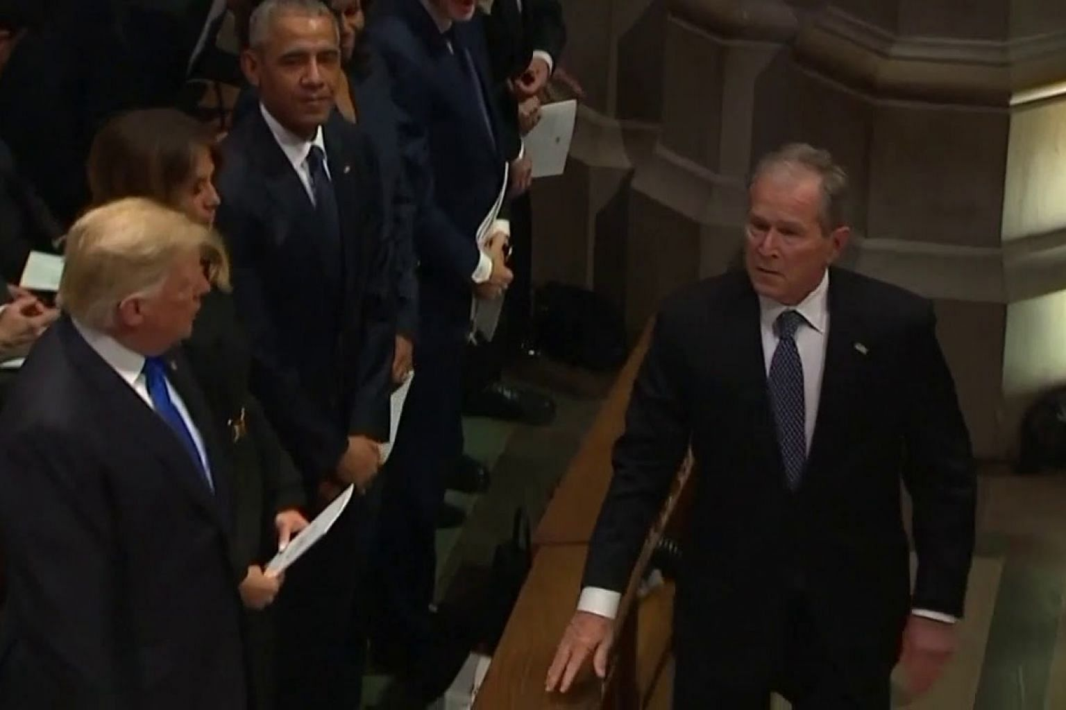 George W. Bush slips Michelle Obama another treat