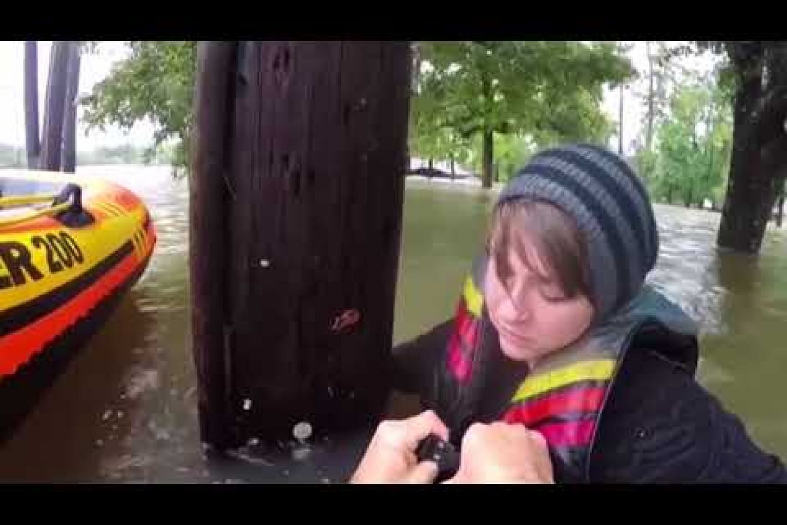 Body camera shows harrowing water rescue of woman trapped by flood