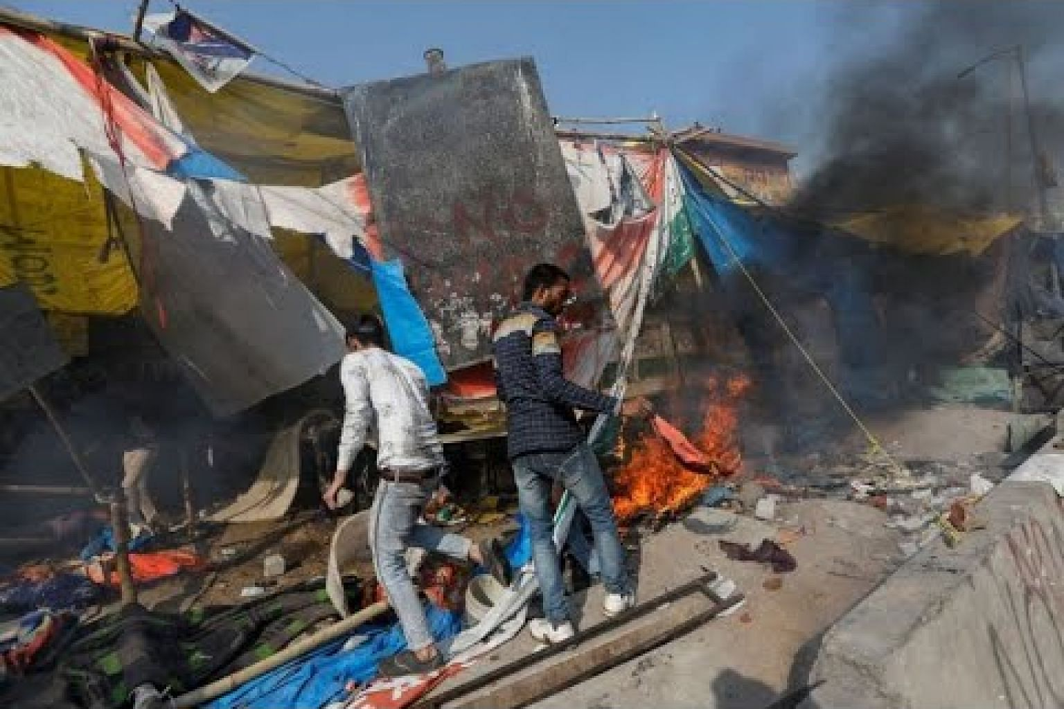 Deadly India riots overshadow Trump's visit