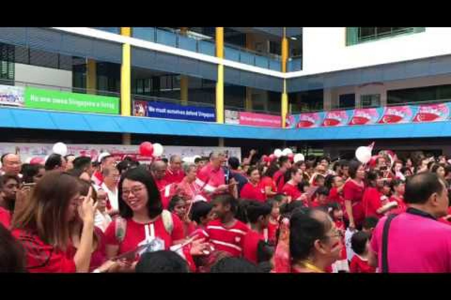 PM Lee and Ho Ching singing this year's national day song with Teck Ghee residents