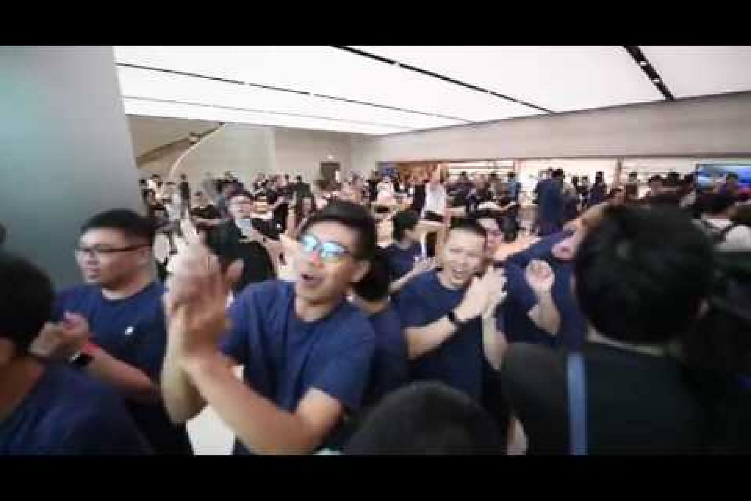 Apple Orchard Road staff cheering as crowd enters the store on opening day (2)
