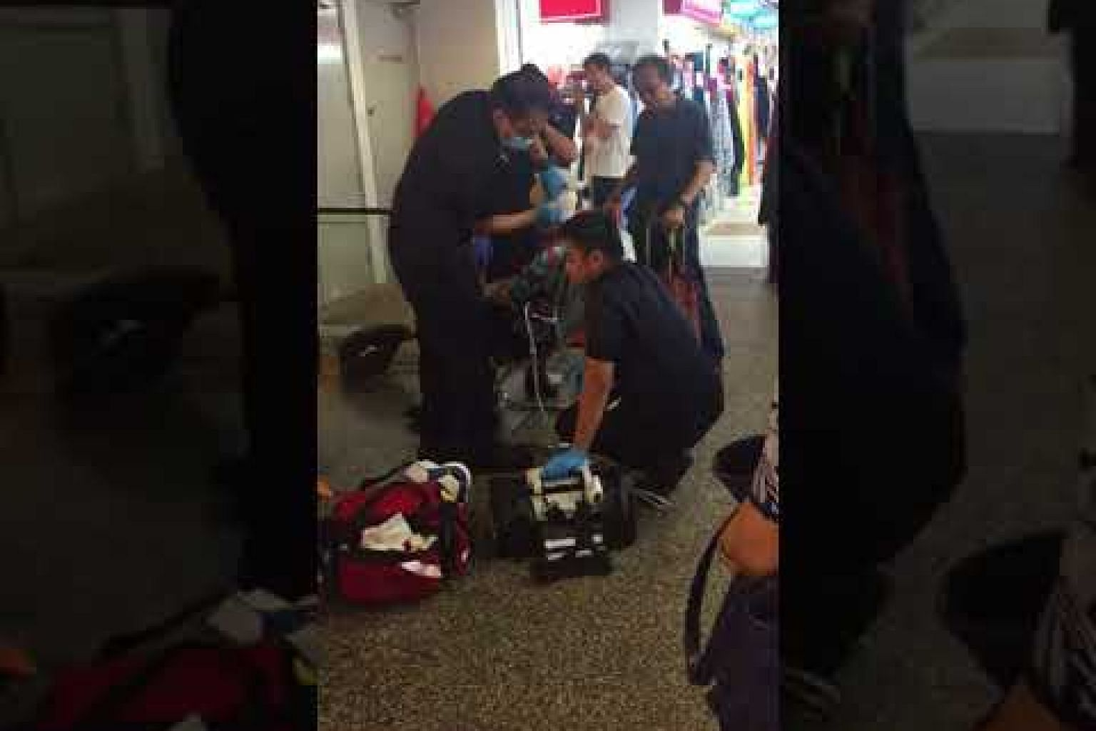 Woman falls at People's Park Complex