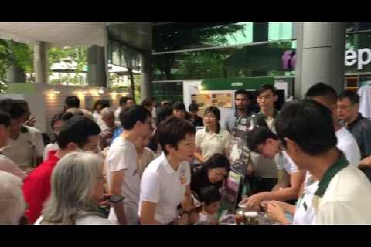 Grace Fu touring the booths at NParks' Festival of Biodiversity at NEX