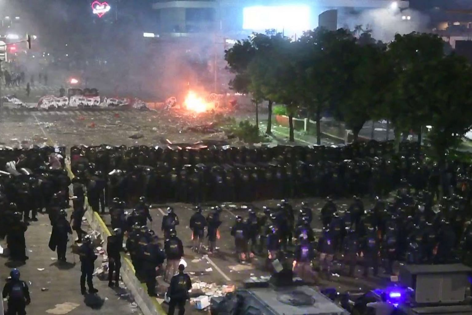 Protesters clashing with police in Jakarta